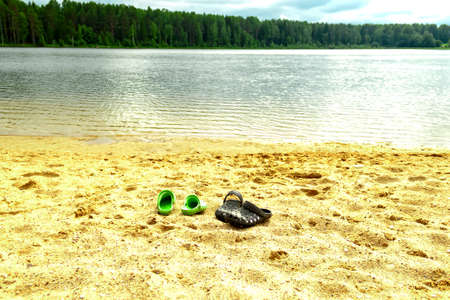 River, lake shore, sandy beach on forest natural background, summer nature vacation holiday concept