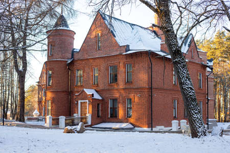 Herzen sanatorium village, Russia - December 06, 2020: Vasilievsky English castle Sherbatov manor country estate main building. Close up. Selective focus. Copy space