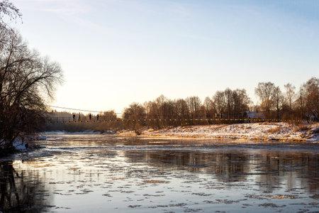 Village Vasilyevskoye, Russia - December 06, 2020: suspension foot bridge over the Moskva Moscow River on nature background