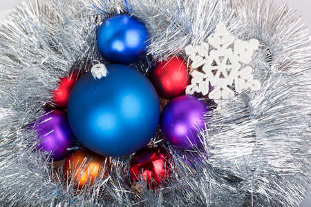 Group of Christmas balls in the chain with snowflake on a white background photo