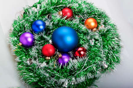 Christmas balls in green garland with Christmas bells on a white background photo