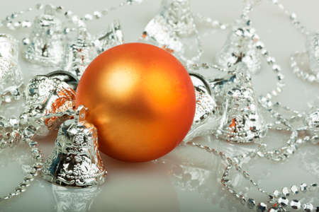silver bells: Orange Christmas ball with silver bells