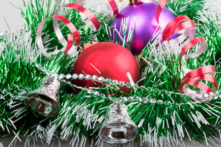 silver bells: Christmas balls with green garland and silver bells