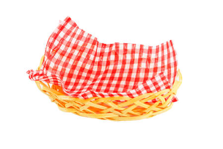 suppertime: wicker basket with a checkered napkin isolated on white background