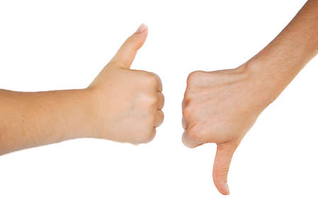 Thumbs up and down isolated on white background photo