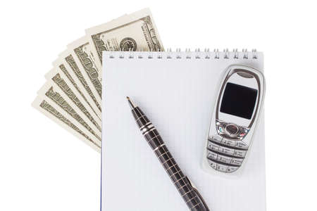 dollars, notepad, pen and mobile phone on a white background photo