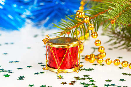 red drum under the tree with gold beads photo