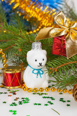 Christmas white teddy bear with decorations under the Christmas tree photo