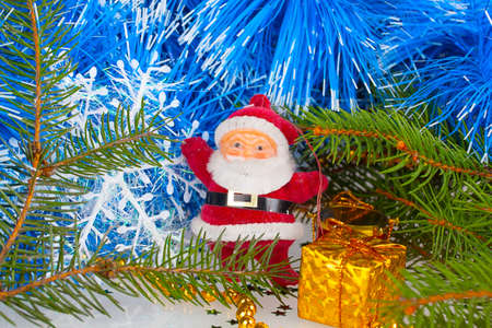 Santa Claus with gift under the Christmas tree photo