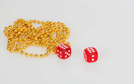 red dice and gold beads photo