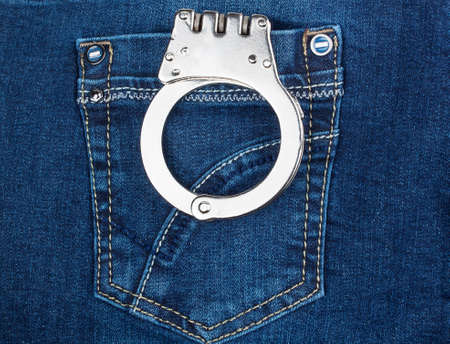 handcuffs in blue jeans pocket Stock Photo - 24568605