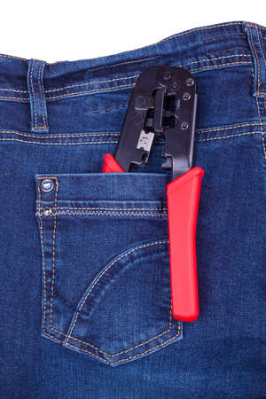 crimping: Crimping tool in a pocket of blue jeans Stock Photo