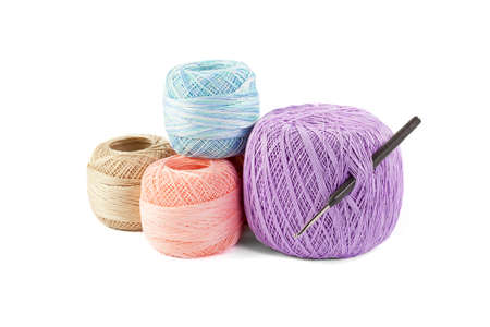 weave ball: four skeins of yarn and hook isolated on white background Stock Photo