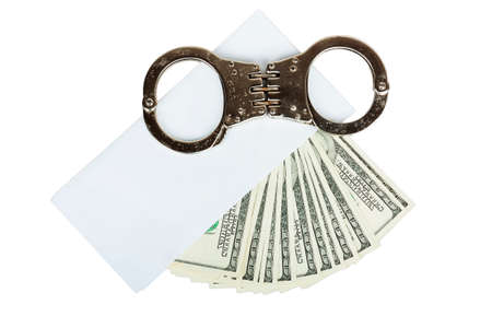 money in a white envelope with handcuffs isolated on white background photo