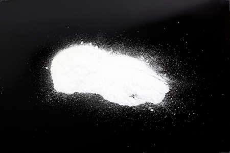 junky: heroin on a black background