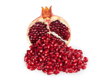 half of pomegranate and pomegranate seeds isolated on white background photo