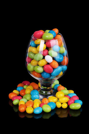 colorful candy in glass isolated on black  photo