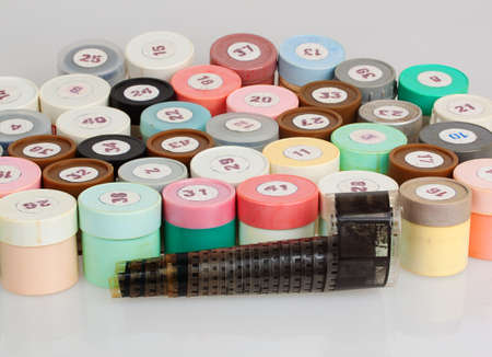 many filmstrips in plastic containers photo