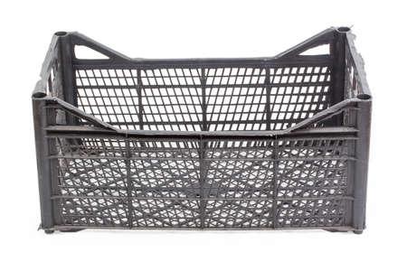 black plastic crate of fruit isolated on white background photo
