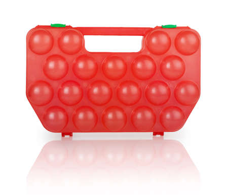 red plastic case for eggs isolated on white  photo