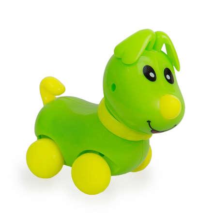 Green plastic dog toy isolated on white background photo