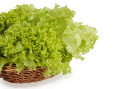 green lettuce in a wicker basket isolated on white background photo