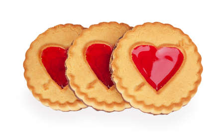 three cookies with a heart of jelly isolated on white background photo