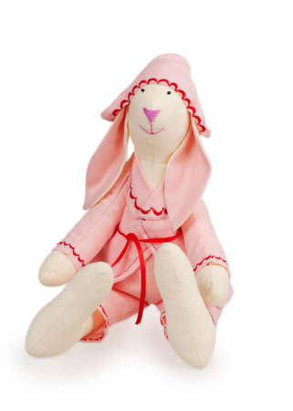 Textile handmade rabbit toy isolated on white background photo
