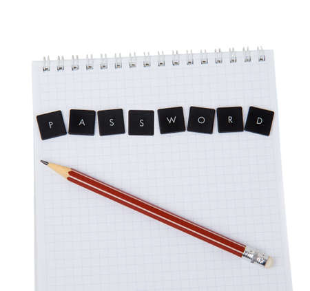 Notebook and pencil with the word password on a white background photo