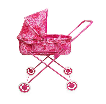 Toy pink pram isolated on a white background photo