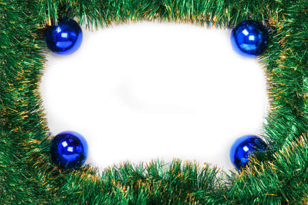 Frame of green Christmas garland with blue balls on a white background photo