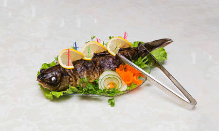 stuffed fish: Stuffed fish on a platter on the table