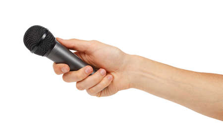 Black microphone in the hand isolated on white background photo