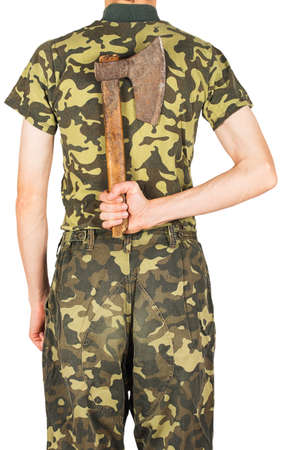 infantryman: Soldier in uniform with an ax behind his back isolated on white background Stock Photo