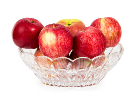 Red apples in a glass vase isolated on white background photo