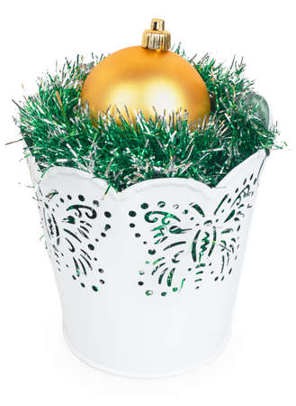 Golden Christmas ball and the green garland in decorative white bucket isolated on white background photo
