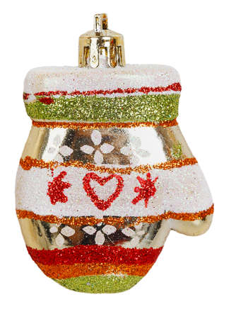 Bright Christmas tree toy gold mitten isolated on white background photo