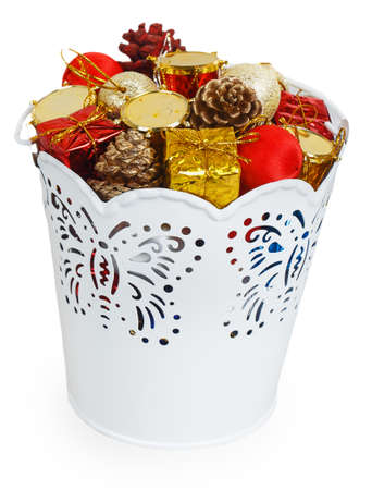 dumps: Golden Christmas gifts and dumps in decorative white bucket isolated on white background