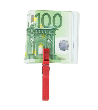 laundered: Euro bills held together by a red clothespin isolated on white background