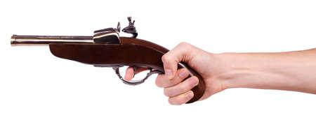 flint gun: Pistola mosquete antiguo en la mano masculina aislado sobre fondo blanco Foto de archivo