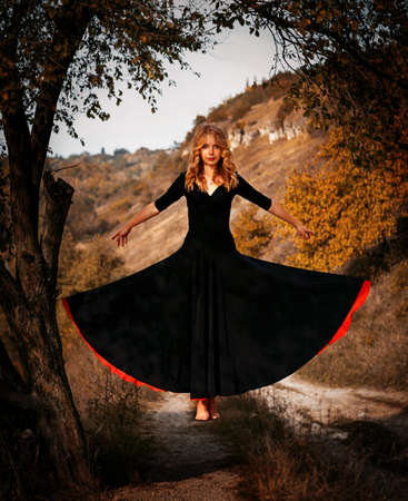 levitating: Young woman levitating in the forest Stock Photo