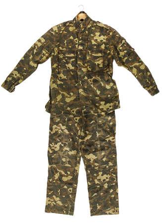 Camouflage jacket and pants isolated on white background photo