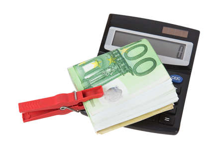 laundered: Euro bills held together by a red clothespin with calculator isolated on white background