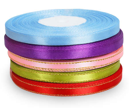 favours: Bright spools satin ribbons isolated on white background