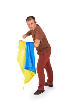 threatens: Young man threatens his fists with flag of Ukraine isolated on white background