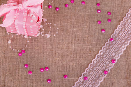 git: Background of burlap with pink git box and pink lace Stock Photo