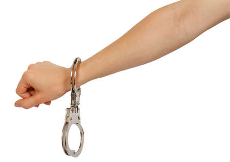 Female hand in handcuffs isolated on white background photo