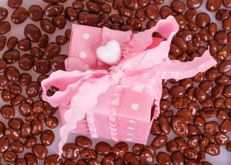 dragees: Pink gift box with chocolate dragees Stock Photo