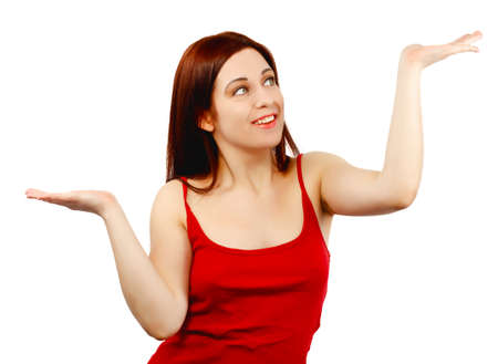 unbalanced: Young woman holding her hands out as if balancing or weighing something isolated on white background Stock Photo