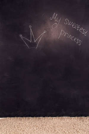 sweetest: Close up of a black dirty board with the words my sweetest princess and crown